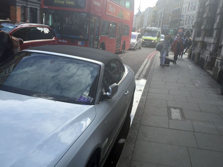 An Audi with a parking ticket on the windscreen