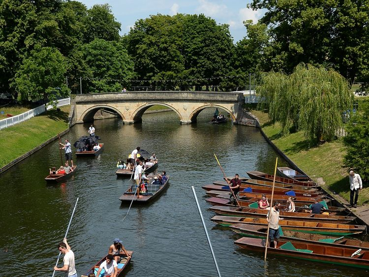 Sunseekers enjoy punting on the River Cam in Cambridge