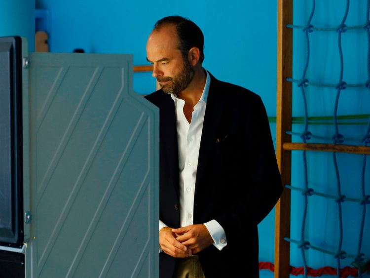 Prime Minister Edouard Philippe casts his electronic vote at a polling station
