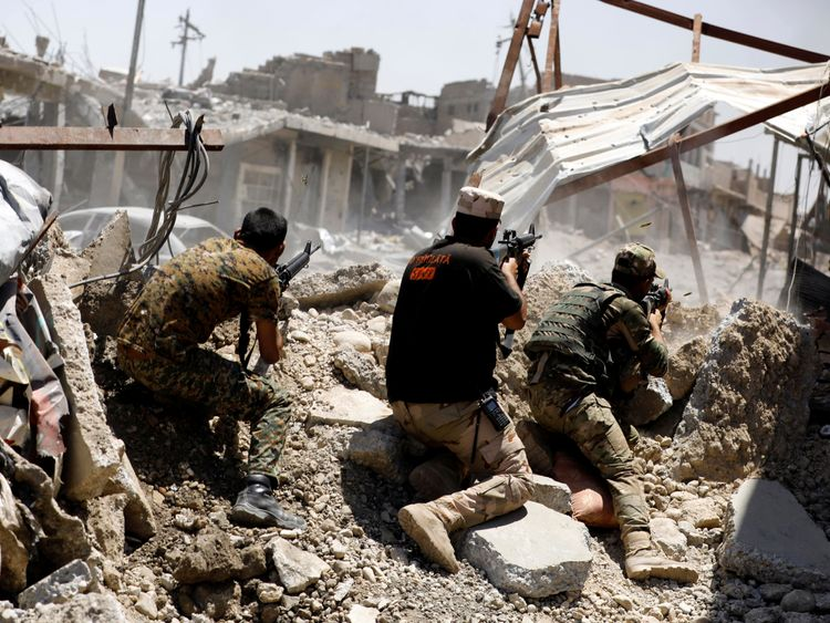 Iraqi soldiers fire their weapons towards the Islamic State militants positions in Mosul's al-Zanjili's district in Iraq June 7, 2017