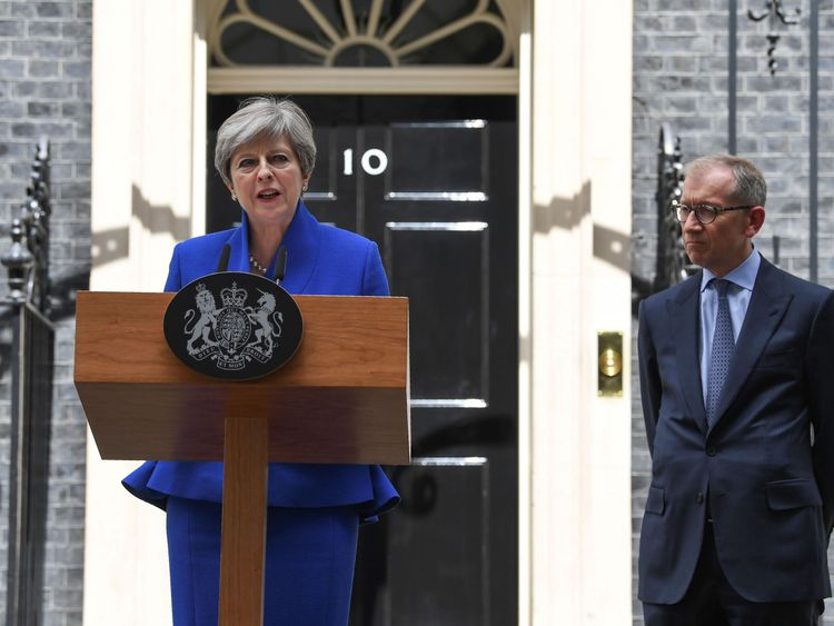 Theresa May, accompanied by her husband Philip, delivers a statement outside 10 Downing Street