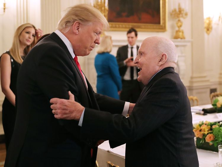 US President Donald Trump greets former General Electric CEO Jack Welch
