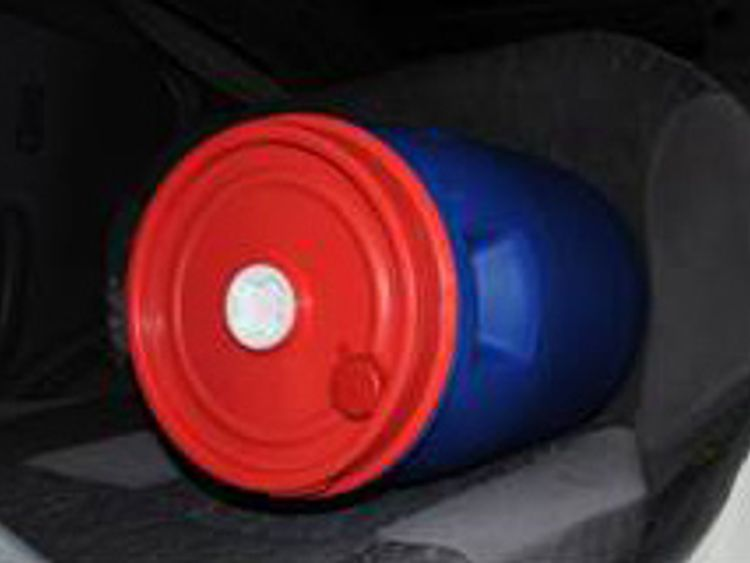 The blue and red barrels were stored in the white Nissan Micra