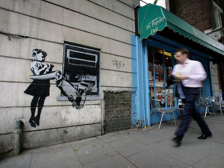 This London cash point was painted by the artist Banksy in 2007