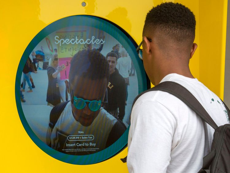 A Snapchat fan looks at a Spectacles vending machine in Venice, Los Angeles