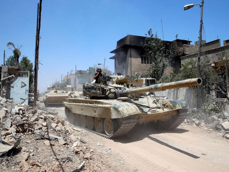 An Iraqi military tanks advances towards Islamic State-held territory in Mosul