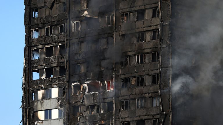The burnt facade of a tower block is seen as firefighters tackle a serious fire at Latimer Road in West London