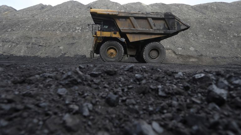 Dump trucks haul coal and sediment at the Black Butte coal mine outside Rock Springs, Wyoming, U.S.