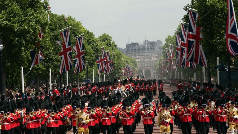 The Royal procession makes its way up The Mall from Horse Guards Parade after Trooping the Colour