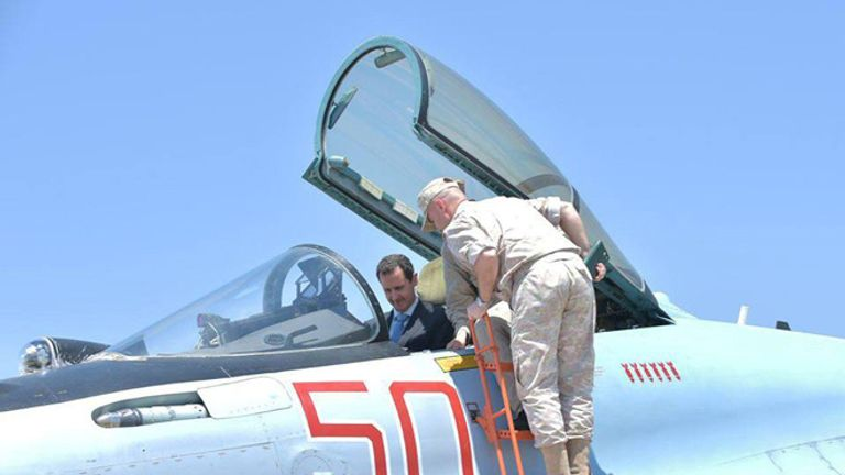 Syria's President Bashar al-Assad visits a Russian air base at Hmeymim, in western Syria