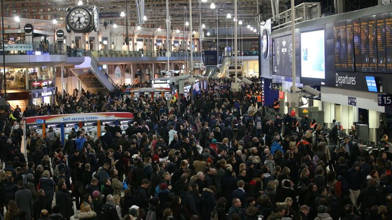 Commuters stand on the concourse at Waterloo station in central London on January 9, 2017, minutes before a 24-hour tube strike is due to end.