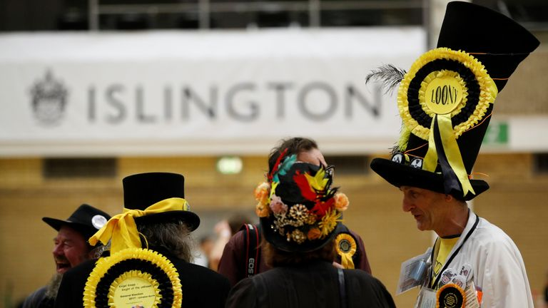 Supporters of the Monster Raving Loony Party await the result of the count in Islington North East