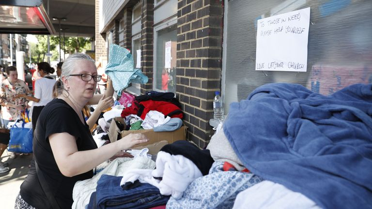 Donated clothes are laid out for those affected by the Grenfell Tower fire