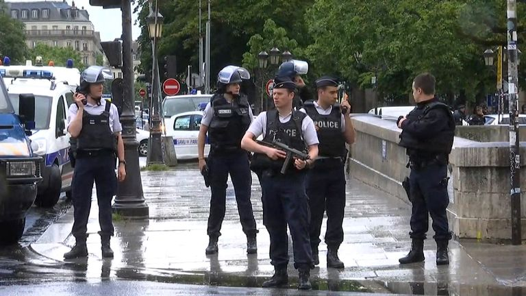 Police respond to an attack at the Notre Dame cathedral