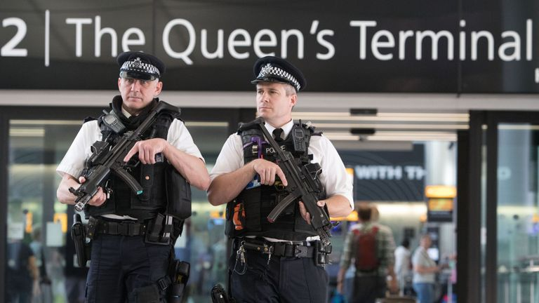 Police officers carry out a patrol in Terminal 2 at Heathrow Airport, west London.