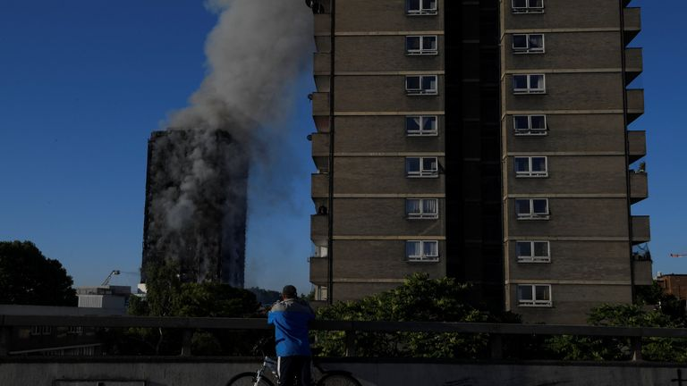 Flames and smoke billow from a tower block at Latimer Road in West London