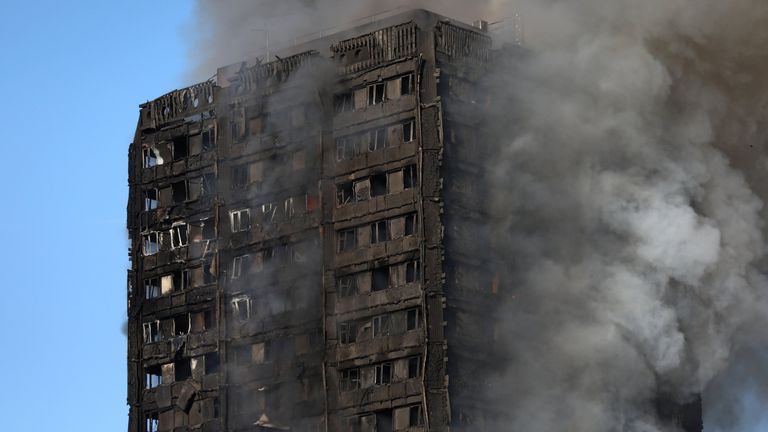 Smoke billows as firefighters tackle a serious fire in a tower block at Latimer Road in West London
