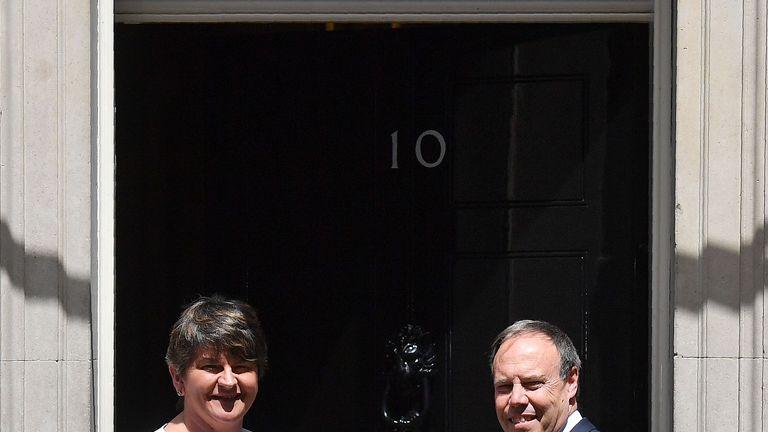DUP leader Arlene Foster (L), and DUP deputy leader Nigel Dodds outside Downing Street