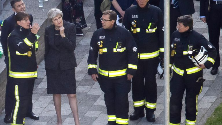 Theresa May speaks to Dany Cotton, Commissioner of the London Fire Brigade, at the scene of the Grenfell Tower fire