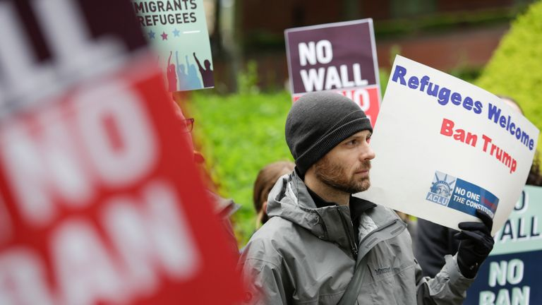 Protesters gather outside a court in Seattle that is preparing to rule on Donald Trump's revised travel ban