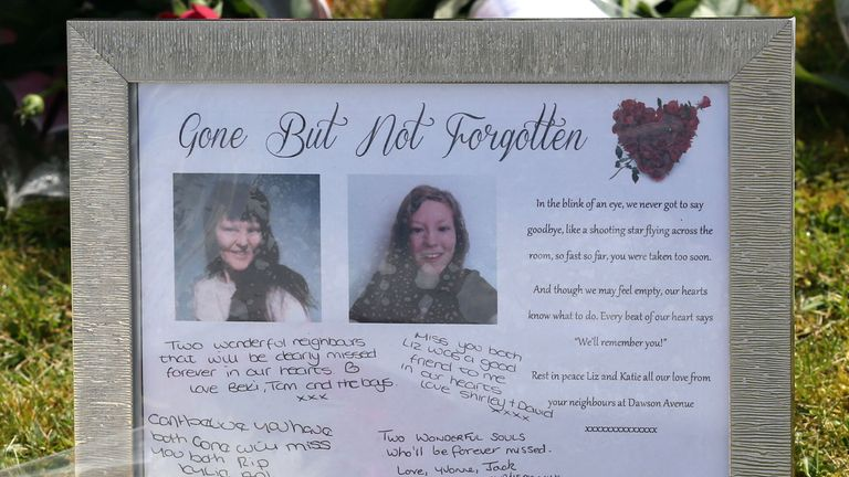 Tributes left outside a house in Spalding, Lincolnshire, where the bodies of 49-year-old Elizabeth Edwards and 13-year-old Katie were found