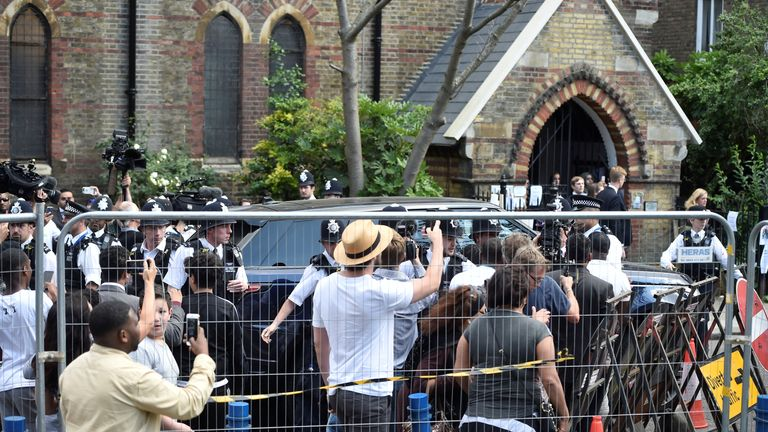 Grenfell tower protesters at church hall where Theresa May is leaving