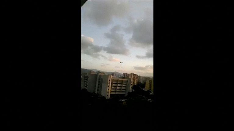 Helicopter firing shots as it flies over Venezuela's supreme court