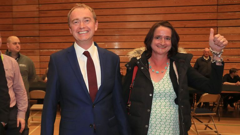 Tim Farron smiles as he arrives for the announcement of his result in Westmorland and Lonsdale