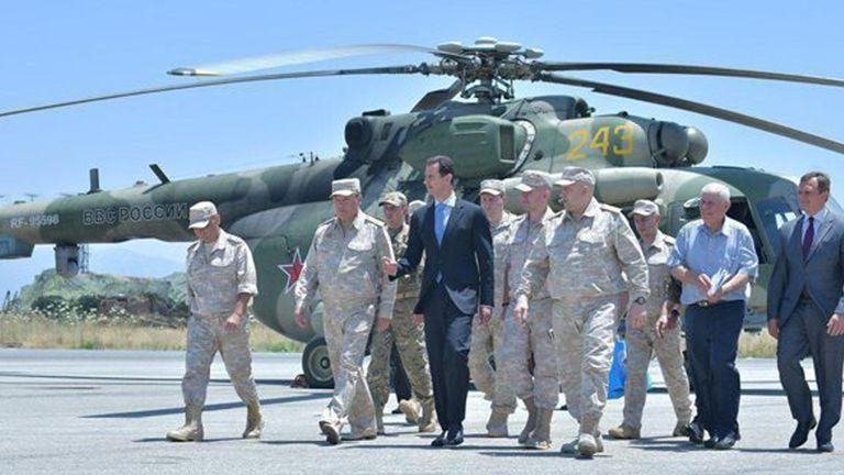 Bashar al-Assad visits a Russian air base at Hmeymim, in western Syria