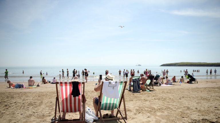 People flock to the seaside to enjoy the glorious sunny weather