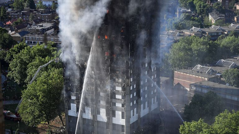 Fire fighters tackle the building after a huge fire engulfed the 24 story Grenfell Tower in Latimer Road, West London