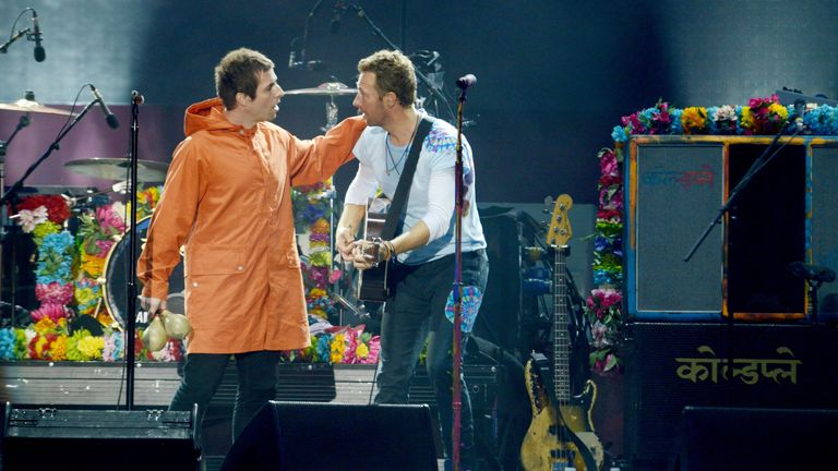 Liam Gallagher and Chris Martin perform during the One Love Manchester benefit concert for the victims of the Manchester Arena terror attack at Emirates Old Trafford, Greater Manchester, Britain June 4, 2017. Dave Hogan/One Love Manchester/Handout via REUTERS ATTENTION EDITORS - THIS IMAGE WAS PROVIDED BY A THIRD PARTY. FOR EDITORIAL USE ONLY. NO RESALES. NO ARCHIVES.