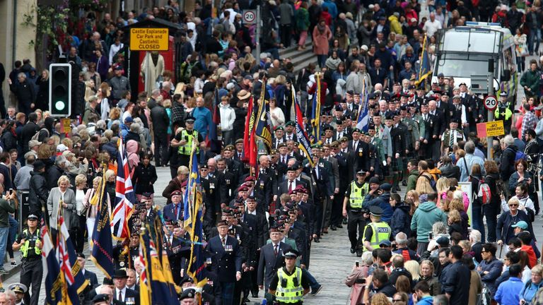 Ex-service personnel from Legion Scotland march down the Royal Mile