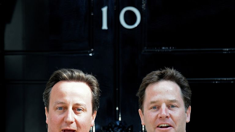 David Cameron and Nick Clegg pose outside No 10 on 12 May 2010