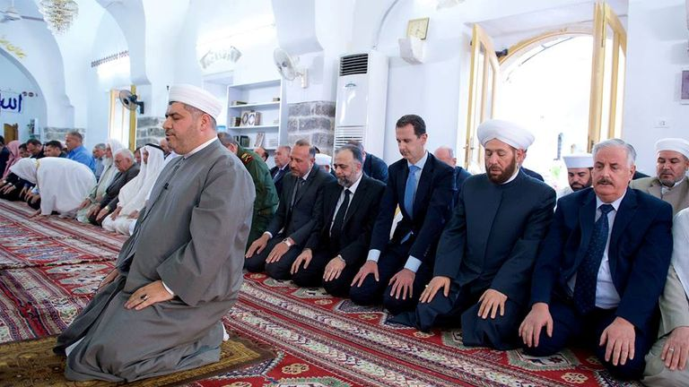 Bashar al-Assad attends prayers on the first day of the Muslim holiday of Eid al-Fitr, inside a mosque in Hama
