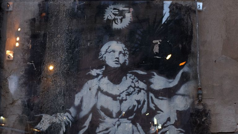 Banksy's only known surviving work in Italy, a mural entitled Madonna with a pistol, in Naples