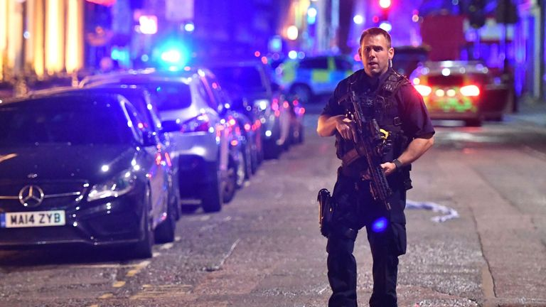 Armed police on Borough High Street as police are dealing with a major incident at London Bridge.