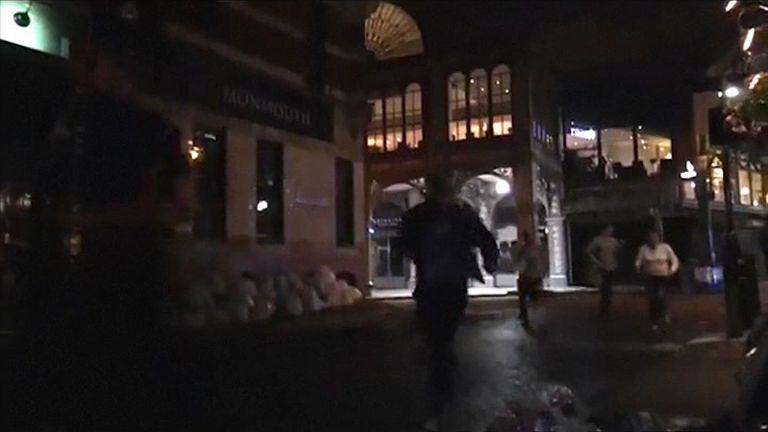 People running in the street fleeing terror attack in London.