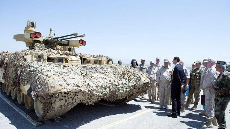 Syria's President Bashar al-Assad visits a Russian air base at Hmeymim, in western Syria