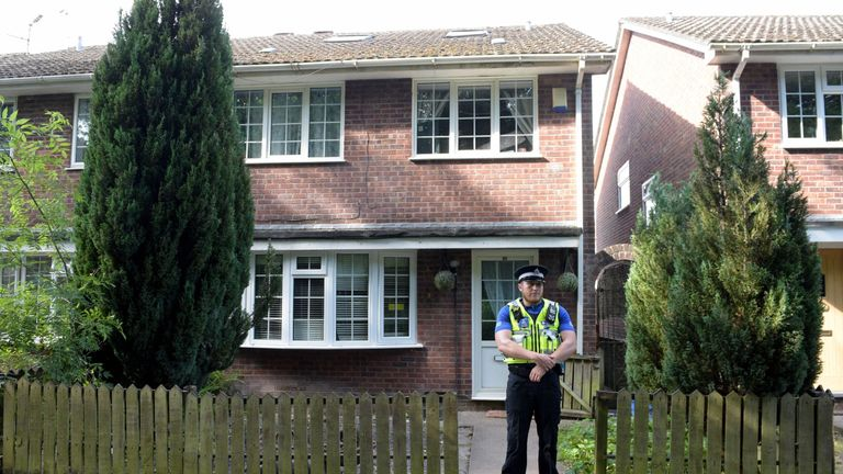 A PCSO stands at the front of a home in Cardiff thought to be connected with the attack in Finsbury Park