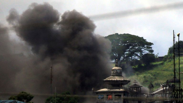 Smoke billows as government troops continue their assault against insurgents from the Maute group, who have taken over parts of Marawi City, Philippines