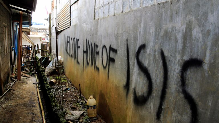 Graffiti on a wall of a back-alley as government soldiers continue their assault against the Maute group in Marawi City
