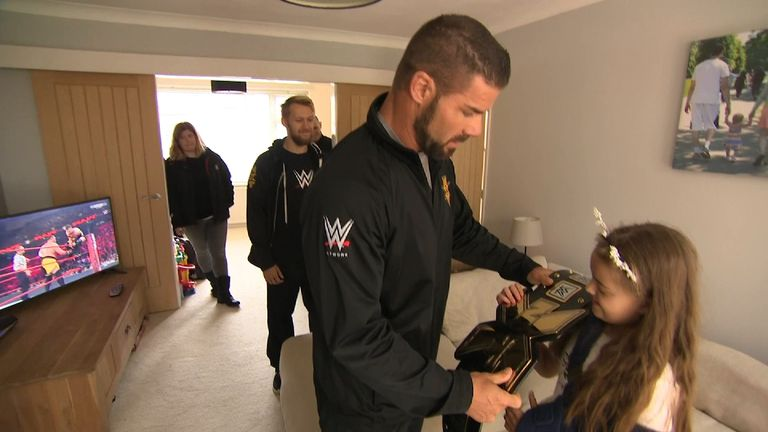 Lily was presented with a WWE championship belt