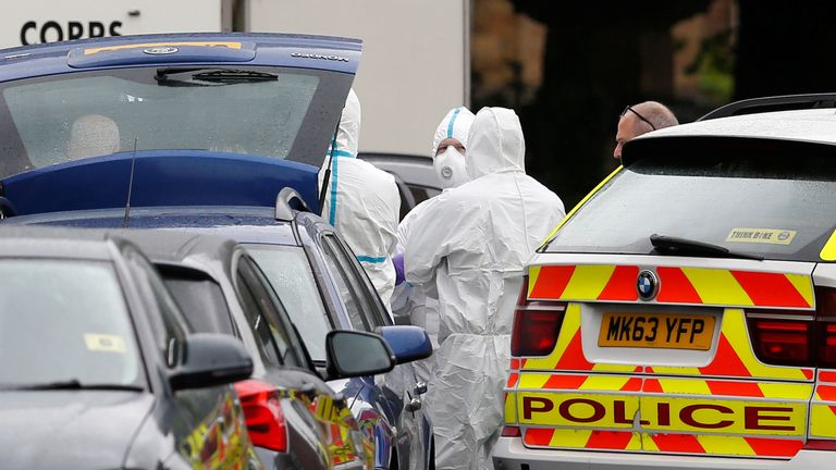 A car is searched by police in Rusholme, Manchester