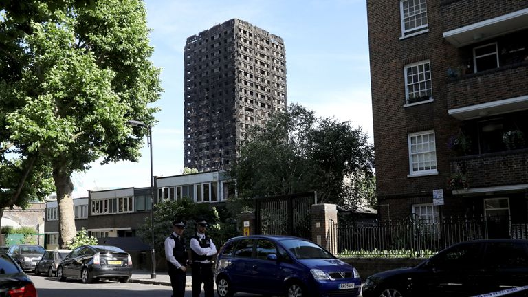 Police stand near Grenfell Tower
