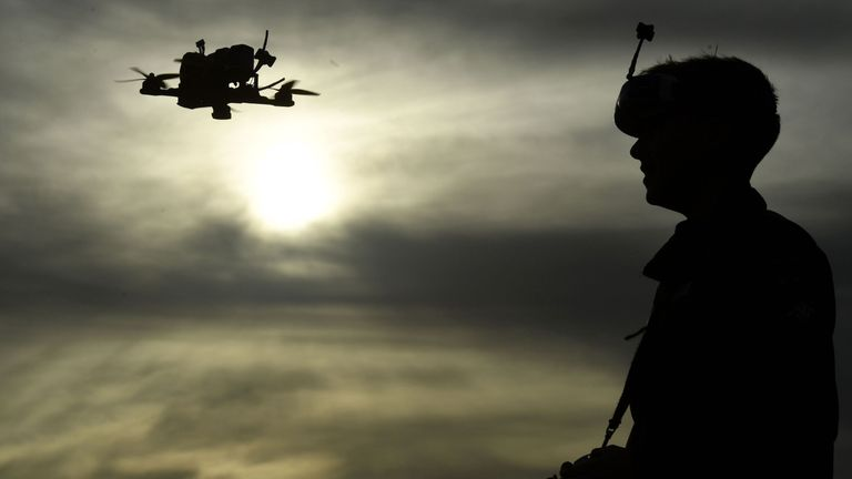 Drone racing champion Luke Bannister poses for a photograph as he flies his first-person view (FPV) drone in Wiltshire, western England, on December 22, 2016, following an interview with AFP