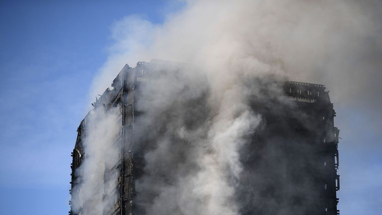 Thick smoke rises from the building after a huge fire engulfed the 24 story Grenfell Tower in Latimer Road, West London