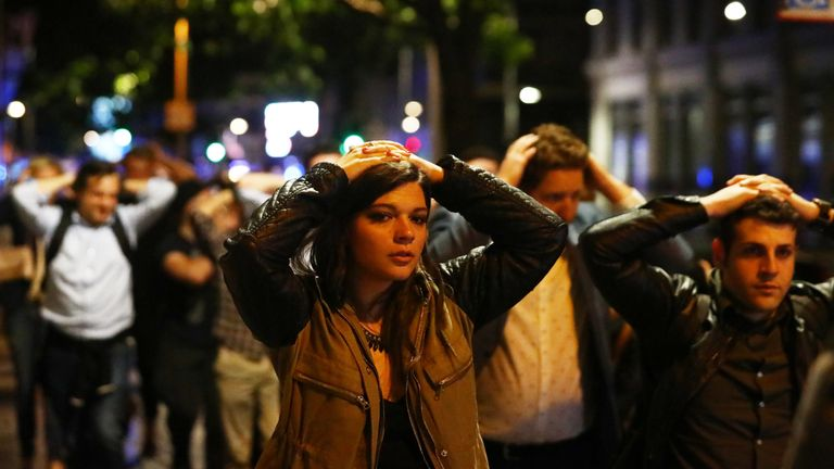 People leave the area with their hands up after an incident near London Bridge in London, Pic: Reuters