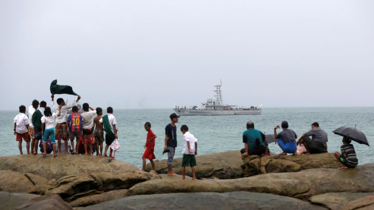 A navy vessel involved in the search for the missing plane