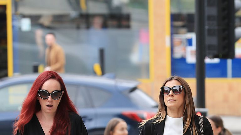 Kym Marsh and Kate Oates (left) arrive at the funeral service of Martyn Hett
